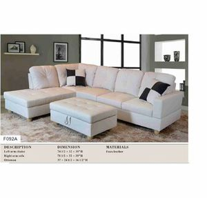 White Leather Sectional with ottoman has Storage ( New ) for Sale in Chico, CA