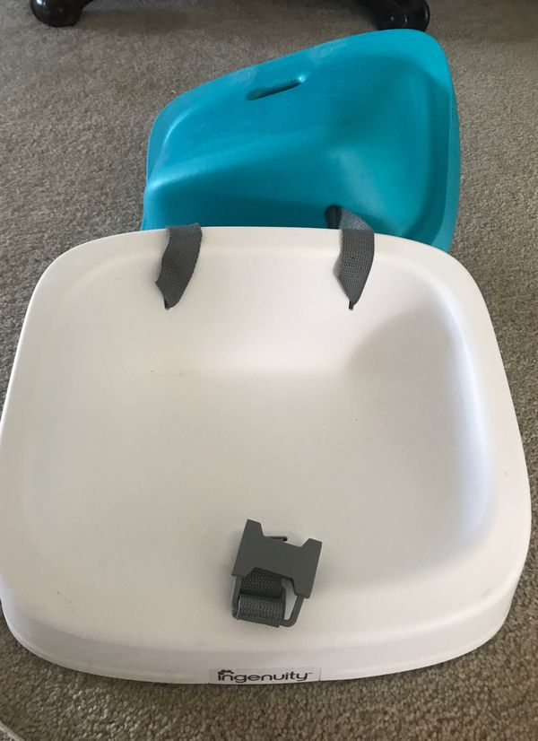 Booster seat. Straps to chair. Rubber/soft seat comes off to clean or for bigger child