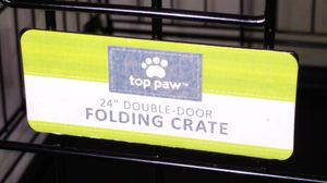 Top paw double door 24 in folding dog crate for Sale in Columbus, OH