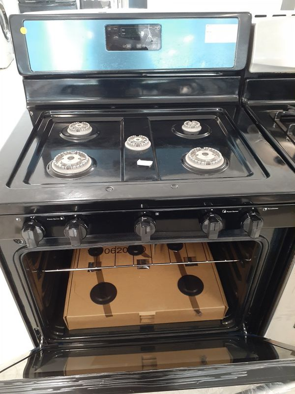 Whirlpool gas stove new scratch and dents with 6 months warranty