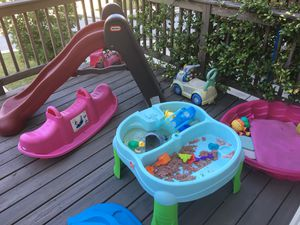 Slide, see saw, water table, toy car , chair for Sale in Smyrna, GA