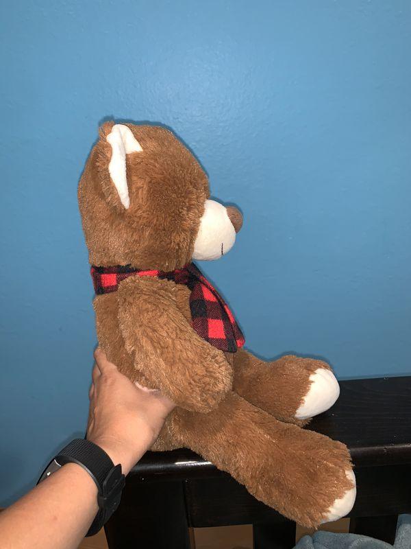 Stuffed bear with scarf