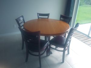 4 ft round Table with 5 chairs for Sale in Port St. Lucie, FL