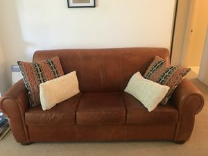 Leather couch; pillows included for Sale in US