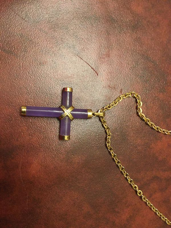 Blue cross with gold plated chain.