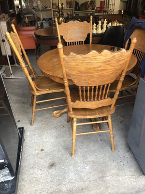 Vintage dining table with four chairs and extension to make table bigger solid piece for Sale in Bloomfield, NJ