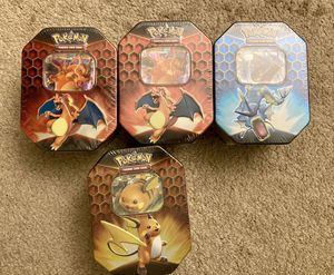 Pokemon Hidden Fates Sealed Tins (Charizard, Gyarados, Raichu) for Sale in Los Angeles, CA