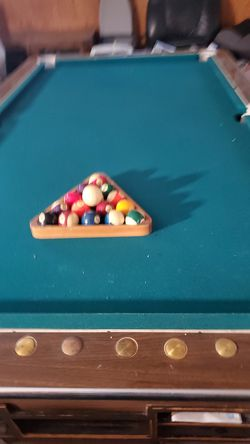 Pool table and cue sticks with wooden stand for Sale in Santa Ana,  CA