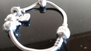 Original pandora sterling silver bracelet with 5 sterling silver charms for Sale in Washington, DC