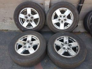 Jeep aluminum 17 inch rims with tires. 5 on 127mm for Sale in Montebello, CA