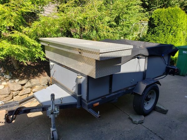 Utility/landscape trailer, 4x6, custom tool box, fabric cover and spare tire mounted. $425