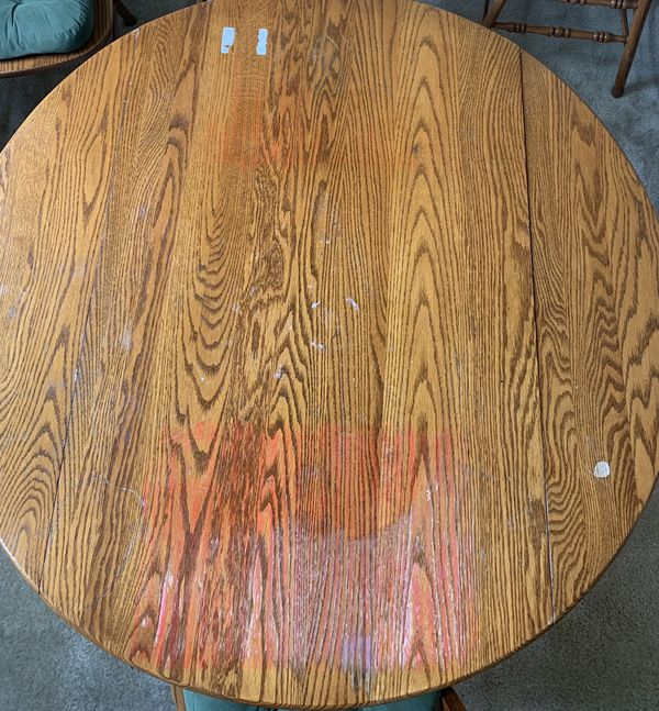 Real wood dining table with 2 dropdown leaves & 4 legs