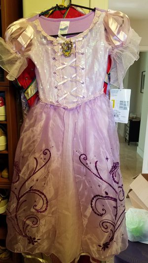 New with tag Disney Rapunzel costume size 7 for Sale in Phoenix, AZ