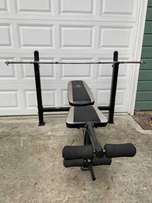 Adjustable bench press with leg developer and 6ft standard bar with screw lock for Sale in Snohomish, WA