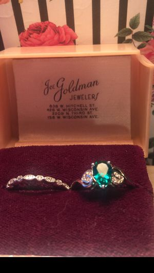 Pretty lab emerald pear shaped with two bands size 7 on silver band for Sale in Northfield, OH