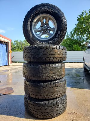 1980 to 2006 JEEP WRANGLER WHEELS AND TIRES 31X10.50 R15 for Sale in Houston, TX