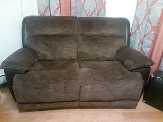 Brown Love Seat In Great Condition Its An Electric Recliner for Sale in Boston,  MA