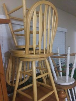5 real solid wood breakfast table style spinning chairs and 2 wood stools for Sale in Everett,  WA