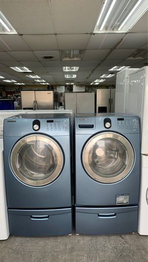 Samsung 4.2 cu. ft. High-Efficiency Front Load Washer and 7.3 cu. ft. Dryer with pedestal for Sale in Garland, TX