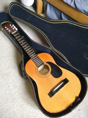 Beginner small guitar w/case and extra strings for Sale in Spokane, WA