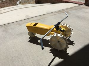 TRACTOR WATER SPRINKLER METAL, AND WHEELS ARE HARD PLASTIC BRAND NELSON ALMOST NEW STURDY HEAVY WORKS GREAT IN GOOD CONDITION ALMOST NEW SEE ALL PICS. for Sale in Apple Valley, CA