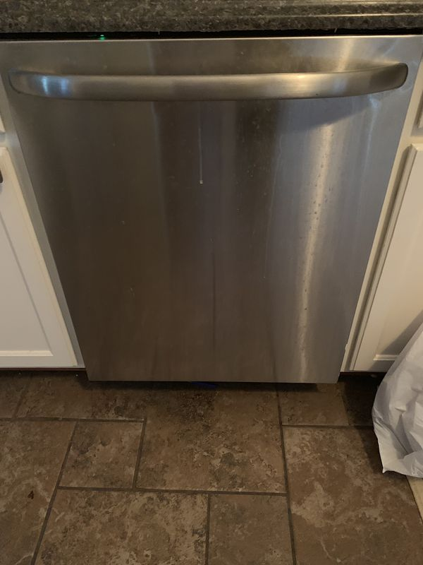 Dishwasher, electric stove, oven, and microwave all in working condition
