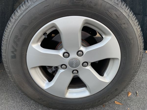 4 stock jeep wheels and tires used