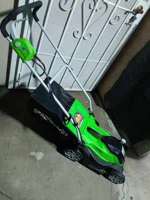 Greenworks small electric lawnmower seems to be new price is firm no lowballers no trades for Sale in Fontana, CA