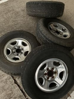 Chevy tires 3 are 95% 1 different and not that good tread have caps for Sale in Clear Lake Shores,  TX