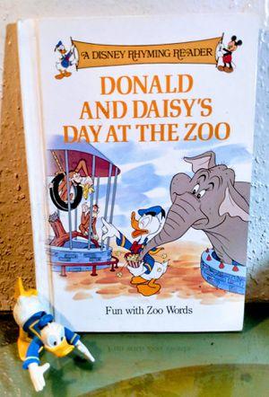 Disney rhyming reader + donald figurine for Sale in Oklahoma City, OK