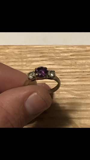 Gold ring with a large pink sapphire and two medium sized diamonds for Sale in Eugene, OR