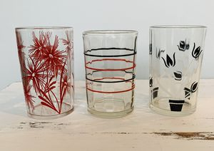 "Set of 3 vintage collectible juice glasses. Red and black floral and stripes designs. Approx 3 1/2"" tall. for Sale in Lakewood, WA"