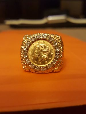 GOLD COIN RING W/ONE DOLLAR LIBERTY GOLD COIN 1851 SIZE 8 DIAMOND BEZEL RING IS 10K, 11.3 GRAMS NUGGET STYLE .I AM FIRM $950. YES STILL AVAILABLE. for Sale in Grand Prairie, TX