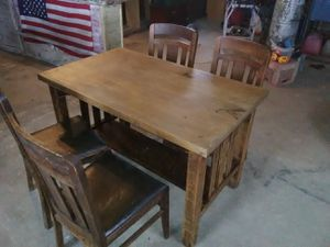 Antique oak table and chairs, original leather on chairs very unique set for Sale in Palmyra, MO
