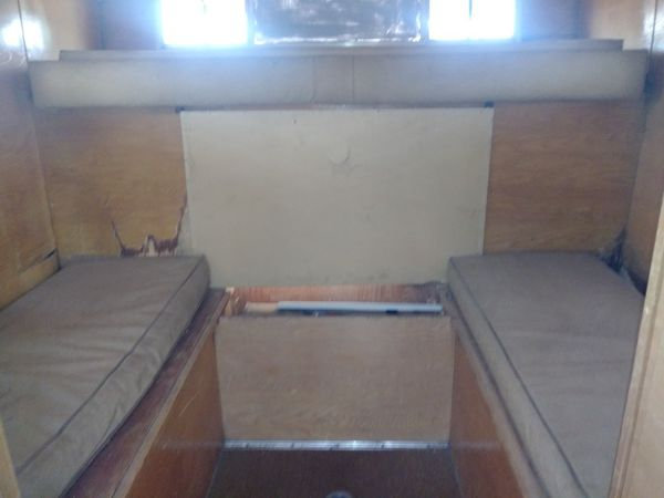 Camper normal wear and tear has a refrigerator, sink and stove. A table and bed .i dont know the measurements