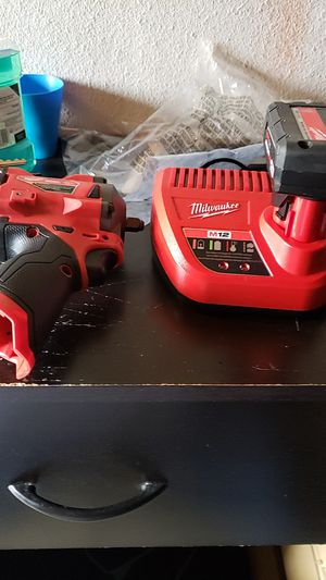"""Milwaukee m12 3/8"""" friction ring impact wrench with battery and charger for Sale in Oceano, CA"""