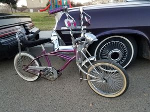 Schwinn convertible Sting Ray pixie lowrider bike white wall tires wire spoke rims Twisted ape hangers cash or trade 13 inch supremes Roadster Daytons for Sale in Dinuba, CA