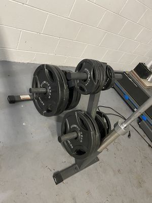 Olympic weight set and bar for Sale in Alafaya, FL