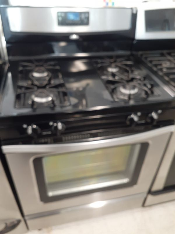 Whirlpool gas stove in good condition with 90 day's warranty
