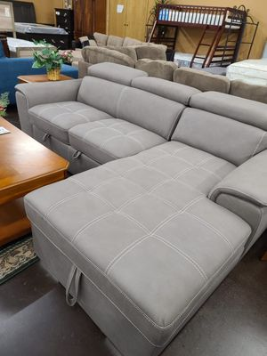 Sofa bed sectional with a storage chaise and pullout bed for Sale in Sacramento, CA