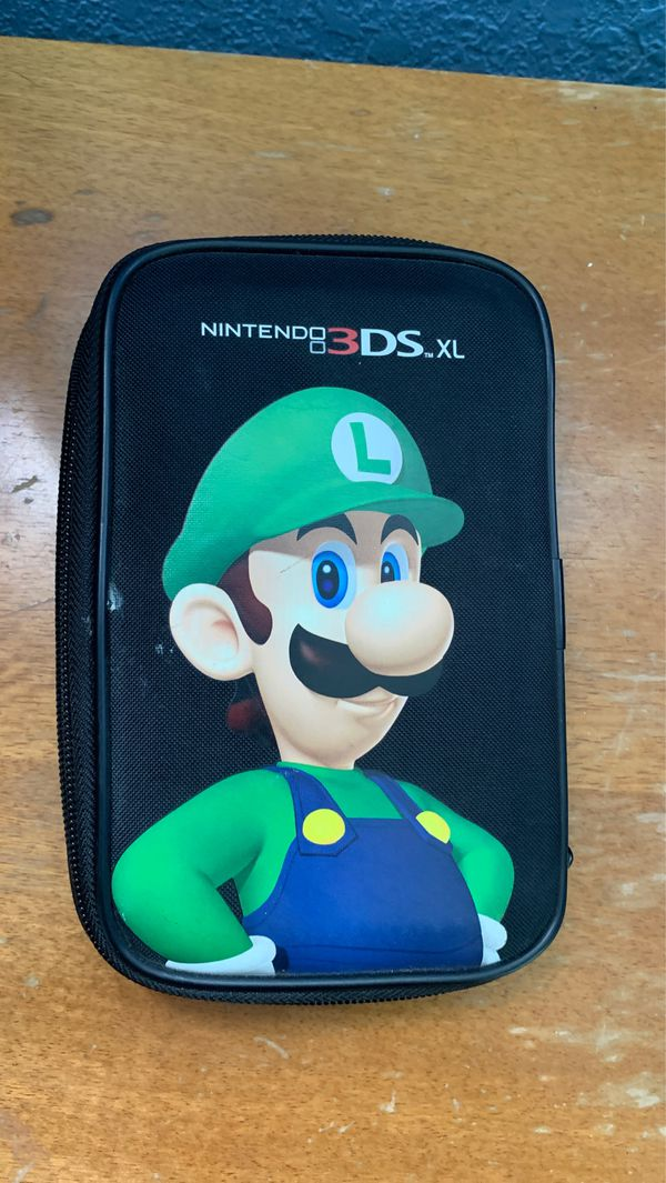 Nintendo 3DS XL, device and games case, device charger, Mariokart 7, Yoshi's New Island, Super Mario 3D Land, New Super Mario Bros. 2