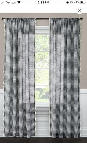 Two dark gray striped curtain panels with pompoms Threshold for Sale in Santa Maria, CA