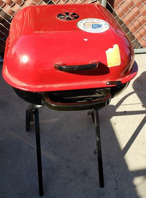 Bbq grill aussie red charcoal unused barbecue folding legs for Sale in Las Vegas, NV