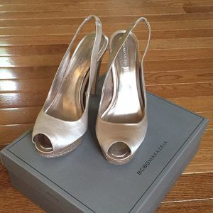 Pair of champagne peep toe shoes, size 8,5 for Sale in Fairfax, VA