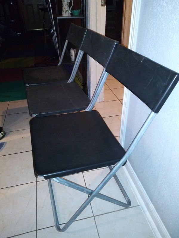 3 black plastic & metal folding chairs 32 inches tall