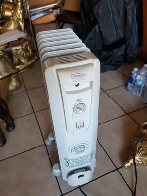 DeLonghi Oil-Filled Radiator Space Heater, Quiet 1500W, Adjustable Thermostat, 3 Heat Settings, Energy SavingComfort Temp EW7707CM for Sale in Franklin Park, IL