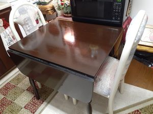 Brown table that folds with 2 multi colored chairs for Sale in Hamburg, PA
