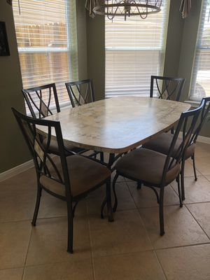 Fossil stone rectangle dining table with 6 matching chairs and 4 matching swivel bar stools for Sale in Kemah, TX