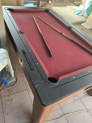 Beautiful wood pool table and Air hockey table. In good condition overall not broken just chipped here and there. for Sale in Fontana, CA