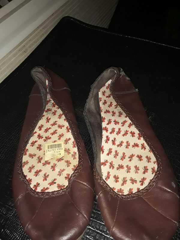 Brown leather flats